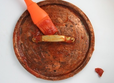 http://www.miss-thrifty.co.uk/2011/05/29/how-to-clean-copper-with-tomato-ketchup/