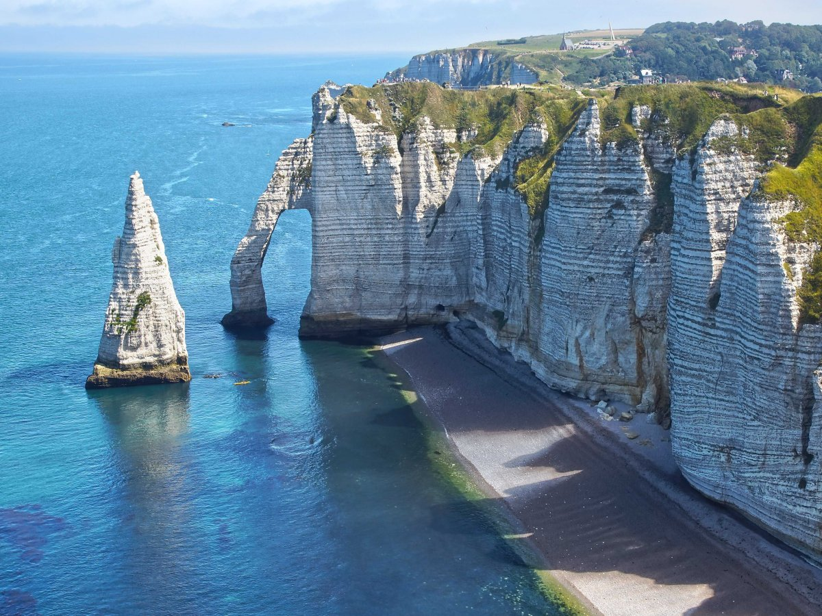 See the chalk cliffs of Étretat in Normandy.