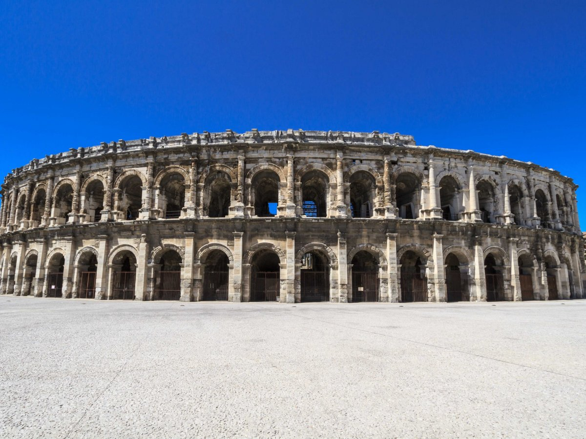 See the ruins of an ancient Roman amphitheater in Nimes.