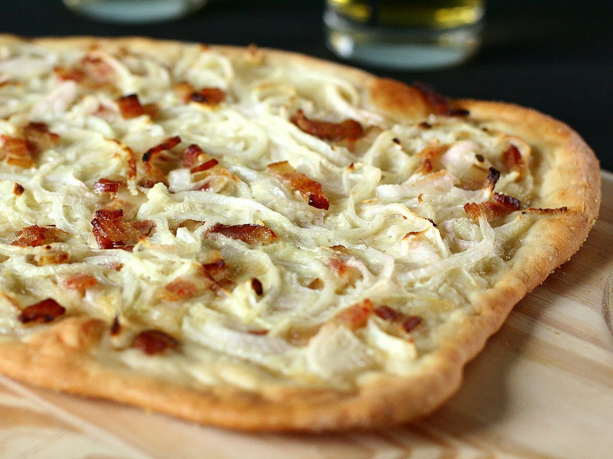 Try a tarte flambée (a type of flatbread pizza usually topped with cheese, ham, and onions) in Alsace.