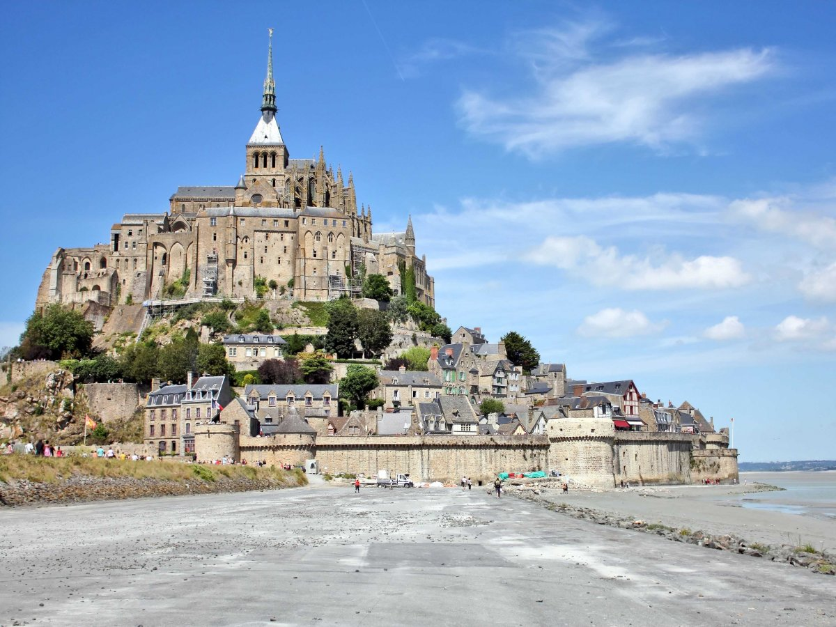 Walk along the mud flats of Mont Saint-Michel Bay during low tide and admire the gorgeous Benedictine abbey.